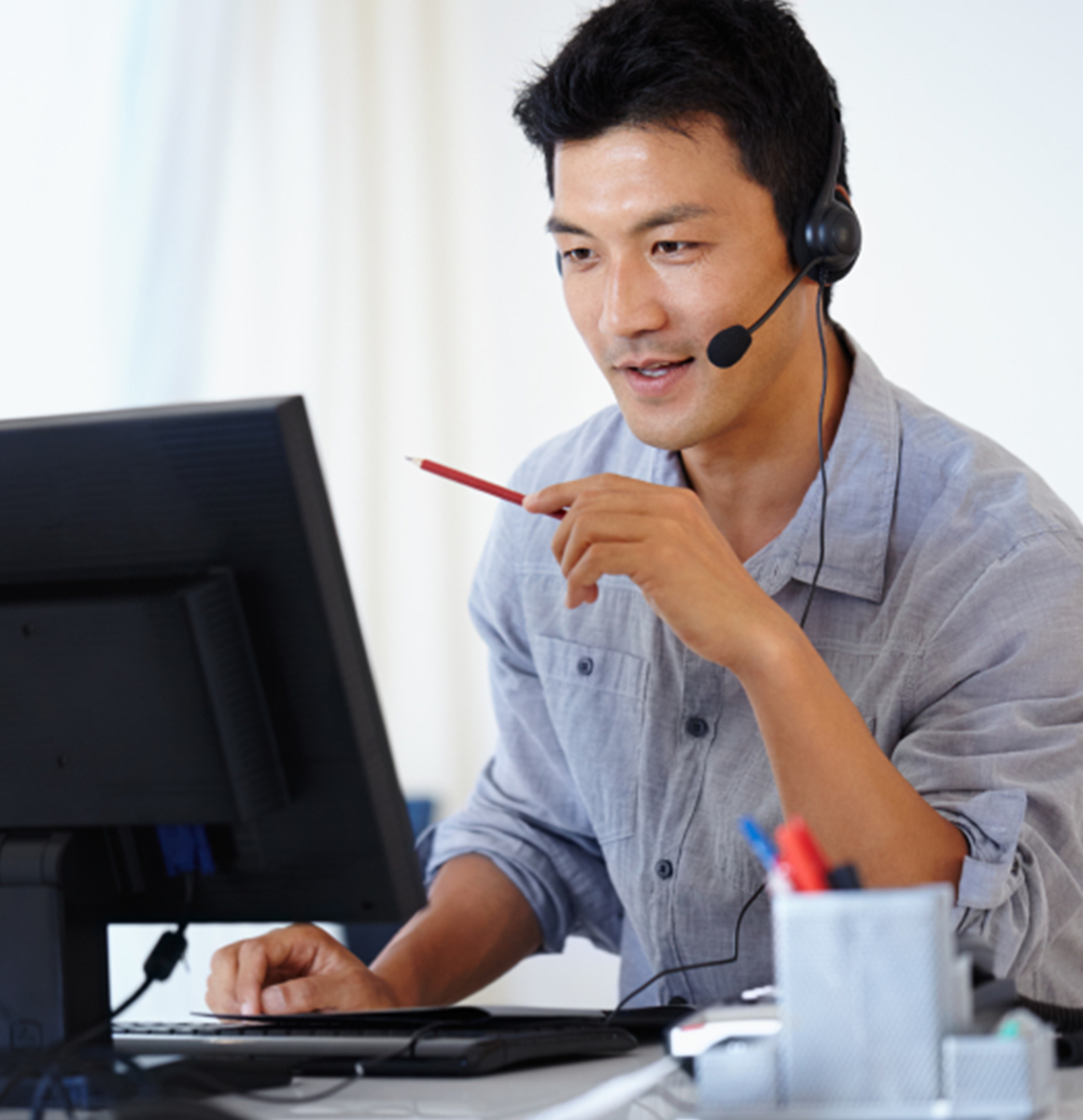 Man with headset offering IaaS solutions powered by VMware and Disaster Recovery Services